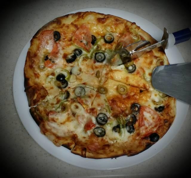 طريقة تحضير بيتزا الصاج بالطريقة