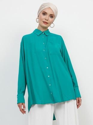 قمصان للمحجبات
